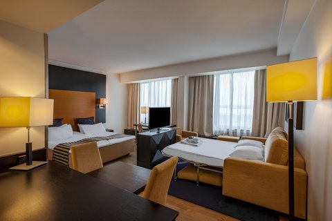 Crowne Plaza HELSINKI - Junior Suite can cater families with sofa opened as extra bed