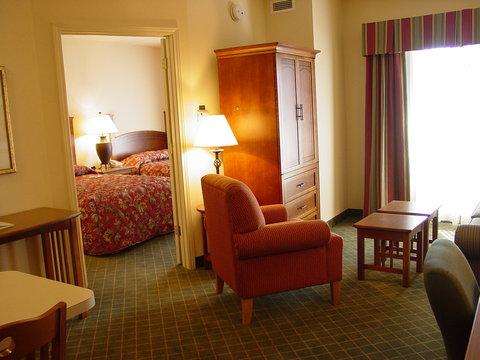 Staybridge Suites AURORA/NAPERVILLE - One Bedroom Living and Bedroom Area