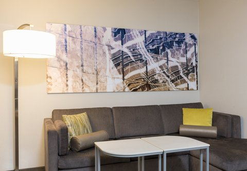 SpringHill Suites Chicago O'Hare - Suite Amenity - Sofa Bed