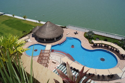 Crowne Plaza TUXPAN - Pool and palapa area from the top