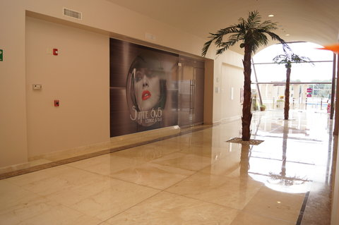 Crowne Plaza TUXPAN - Palm trees Hallway and Entrance to the bar Suite 6 5