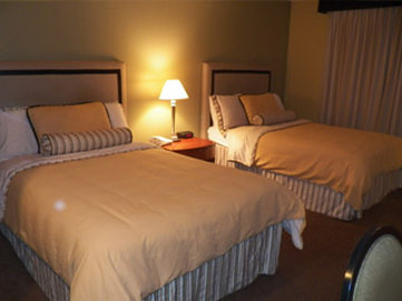 Historic Downtowner Inn And Suites - Beds