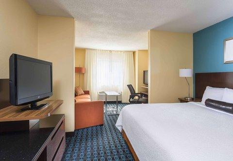 Fairfield Inn & Suites Holland - Executive King Suite Sleeping Area