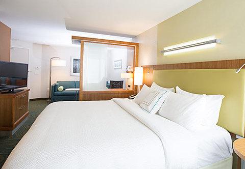 SpringHill Suites Bloomington - King Suite   Sleeping Area