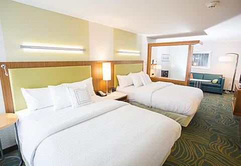 SpringHill Suites Bloomington - Queen Queen Suite   Sleeping Area
