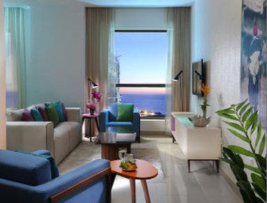 فندق وأجنحة هوثورن من ويندهام - Living Room One Bed Room Suite Sea View