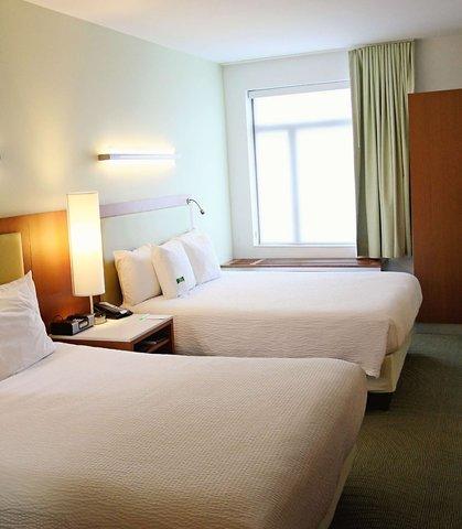 SpringHill Suites Cincinnati Midtown - Queen Queen Suite   Sleeping Area