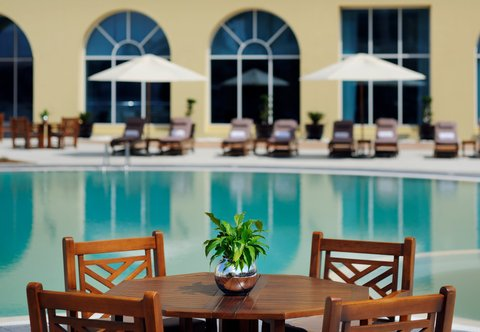 Courtyard Dubai, Green Community - Outdoor Pool Seating Area