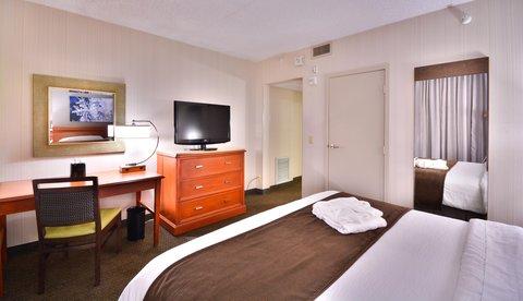 Embassy Suites Hotel-Denver Stapleton - One King Room with Desk   TV