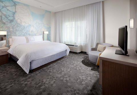 Courtyard Palm Beach Jupiter - King Suite   Sleeping Area