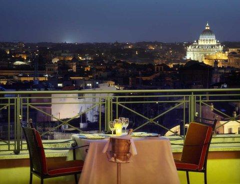 Hotel Bernini Bristol - Small Luxury Hotels of The World - Roof Restaurant at night