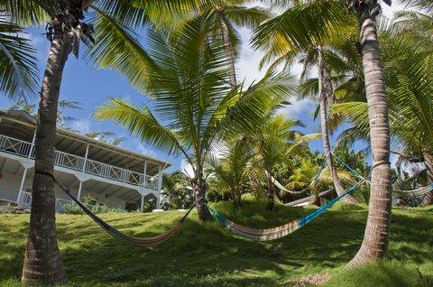 Sea U Guest House - Relax in hammocks