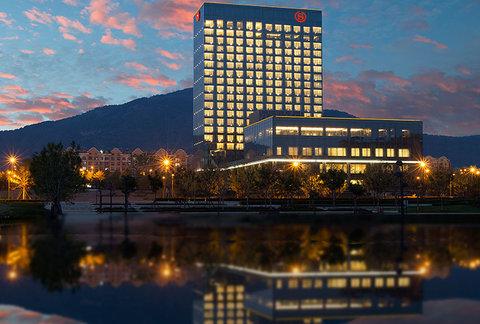 Sheraton Qingdao Licang Hotel - Exterior night view