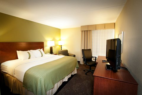 Holiday Inn Fairmont Hotel - King Bed Guest Room with desk office chair and lounge chair