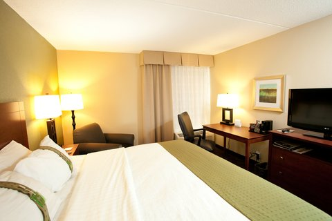 Holiday Inn Fairmont Hotel - Single Bed Guest Room with lounge chair and desk officer chair