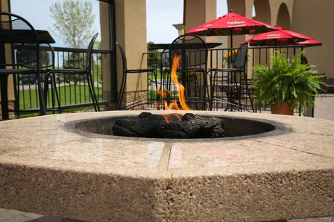 Holiday Inn Fairmont Hotel - Guest Patio with firepits is a great place to rest and relax
