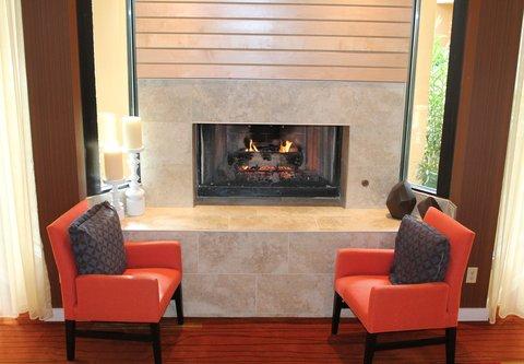 Courtyard Dallas LBJ at Josey - Lobby Fireplace