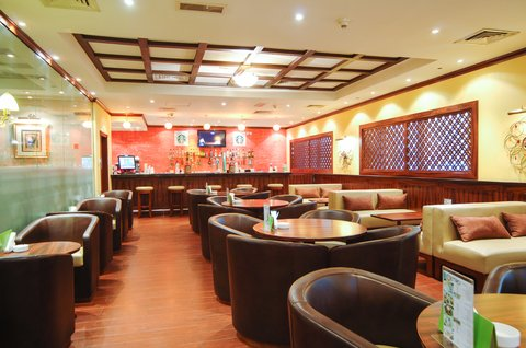 Holiday Inn Downtown Dubai - Realx and Revive yourself at our Metro Bar   Cafe